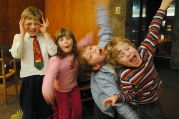Four children laughing and smiling