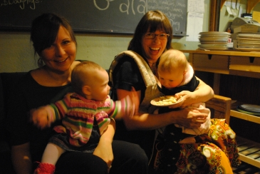 Two women and their babies smiling